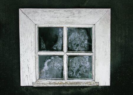 Frozen window pattern. Old rural house exterior