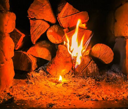 Hot flame and firewood in old stove in the village.