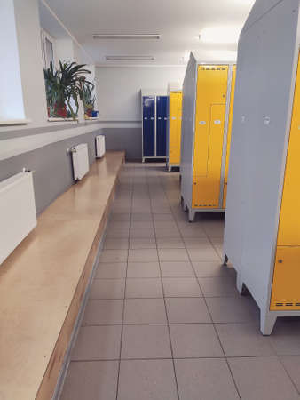 Long corridor of colorful metal modern style lockers in a school