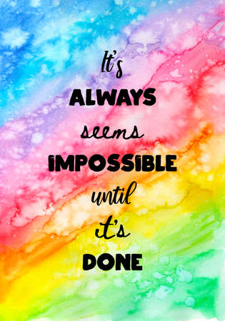 Abstract hand painted watercolor background with inspirational quote. It's always seems impossible until it's done.
