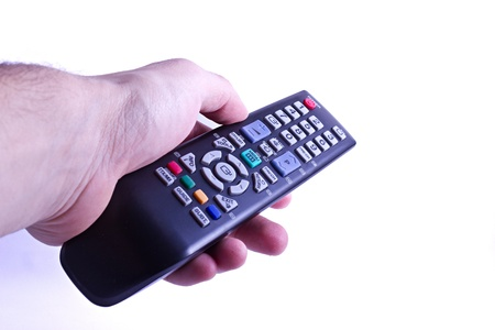 hand holding a TV remote control