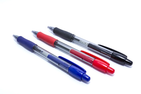 three pens blue, red and black on white