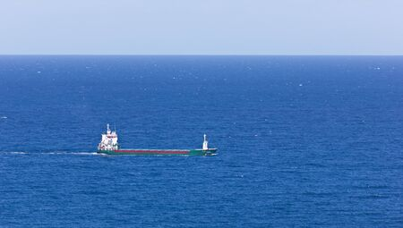 Cargo ship sailing waters of the Cantabrian photo
