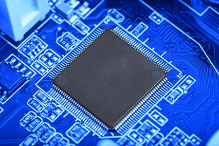 Micro chip on the computer motherboard,blue filter  Stock Photo