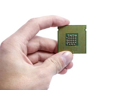 Hand holding processor,isolated background  Stock Photo