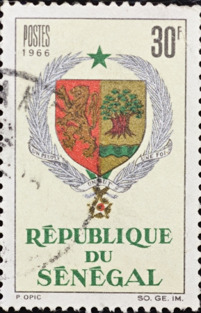 REPUBLIC OF SENEGAL - CIRCA 1966: A stamp printed in Senegal,shows the shield of the Republic of Senegal,circa 1966.