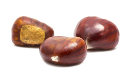 Several chestnuts on white background