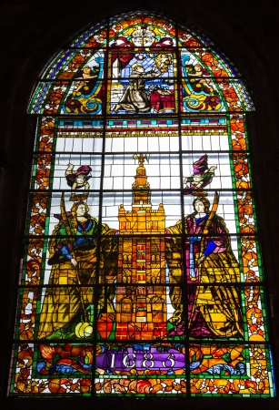 SEVILLA, SPAIN - NOVEMBER 17  The stained glass windows with religious motifs at  Sevilla Cathedral of