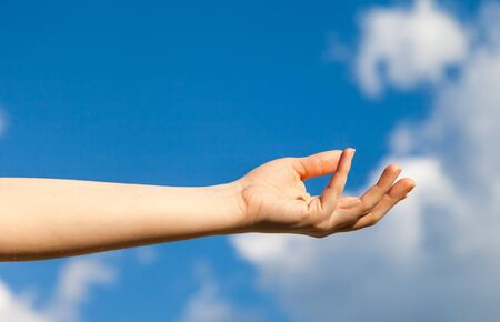 Hand Holding Nothing With Blue Sky Background  Stock Photo - 19472063