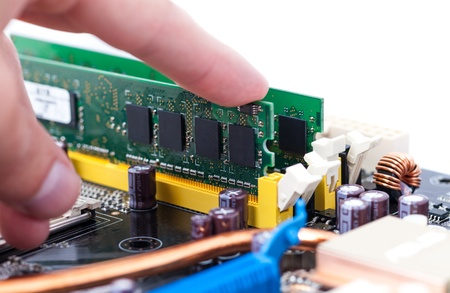Hand Installing RAM Memory Module on PC Motherboard  Stock Photo