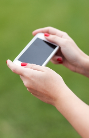 Woman Holding Smartphone with Green Background