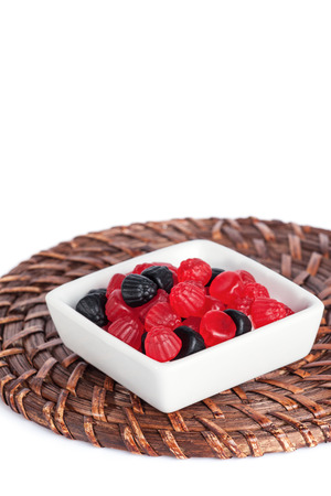 gummie: Blackberry Jelly Red And Black Gummy in a Bowl.