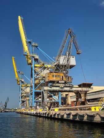 Large, two yellow cranes at an industrial harbor in Gdansk, Poland. photo
