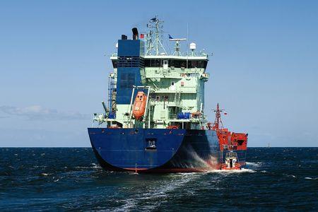 brings: Pilot boat brings tanker to reda. Stock Photo