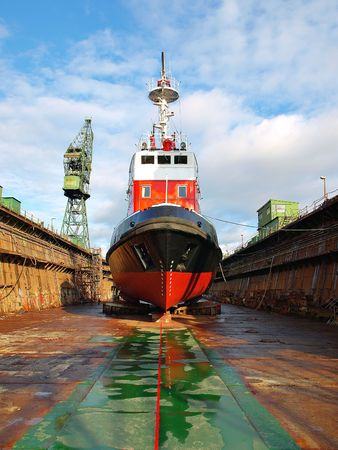 Repair Fire-boat in large floating dry dock photo