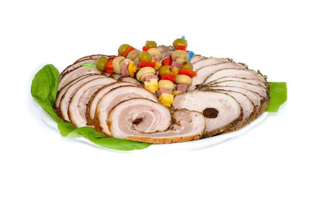 Roulade of bacon slices and pork chop on white plate, close-up, isolated on white background. photo