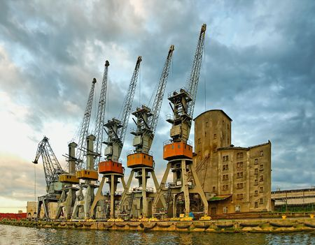 gdansk: Five Samurai and greybeard with a cane. Port cranes in anticipation of the ship, Gdansk - Poland. Stock Photo