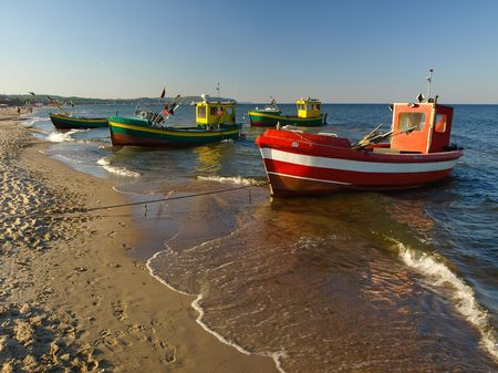 Old fishing boats at the beach in Sopot, Poland.