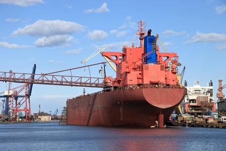 A large cargo ship in the shipyard Stock Photo
