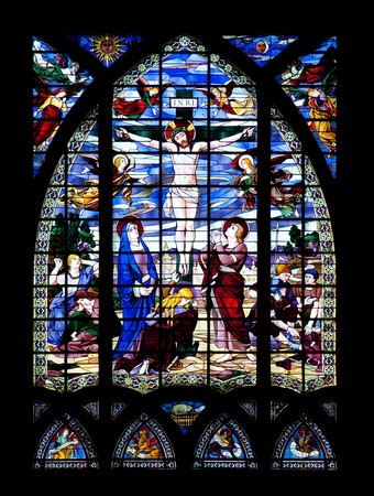 Stained glass window depicting the crucifixion of Jesus Christ. photo