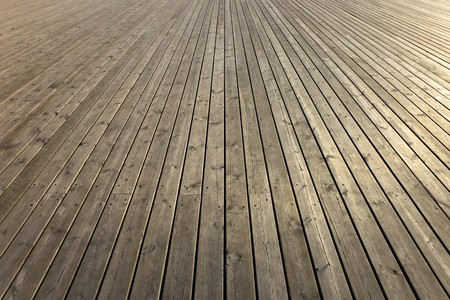 pier: Wooden planks that make up a large pier.