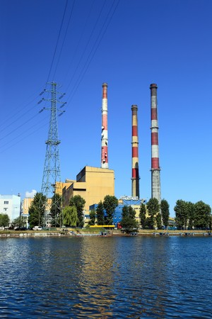 Industrial landscape. Heat station and the river.
