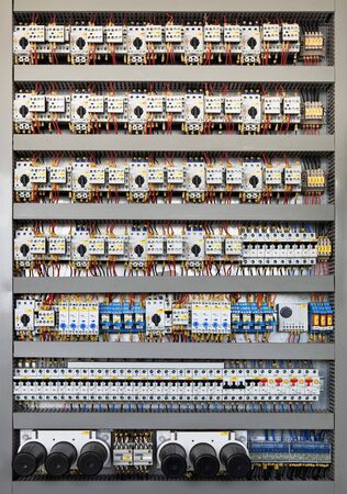electrical wires: Electrical panel at a assembly line factory. Controls and switches.