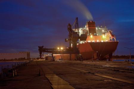 shipyard: A large cargo ship at the port wharf. Stock Photo