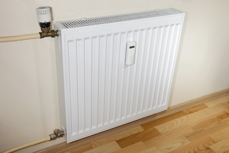 Modern heaterradiator and pipes. photo