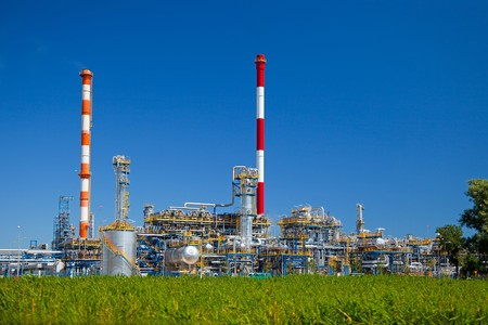 global industry: Oil-refinery, industrial-plant under blue sky.