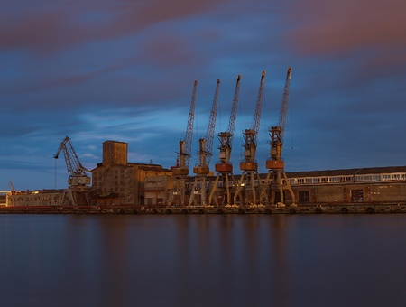 Cranes in harbour at night. Gdansk, Poland. photo