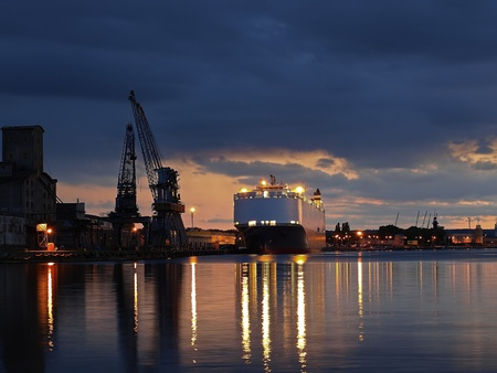A ship carrying cars, berthed at the port of Gdansk, Poland.