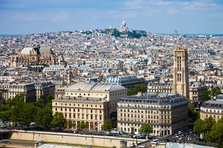 View from Notre Dame in Paris, in the background of the Basilica Sacre Coeur. photo
