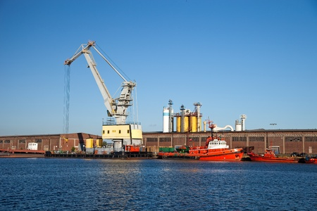 Floating crane standing on the waterfront of the port. photo