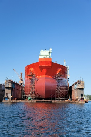 drydock: A large tanker ship is being renovated in shipyard Gdansk, Poland. Stock Photo