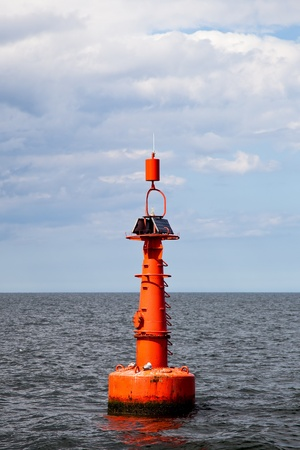 buoy: The red buoy in the Baltic Sea.