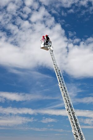 Ladder extended on a fire truck. photo
