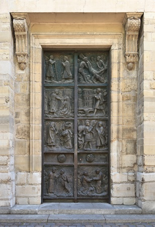 large doors: Ornate door to the medieval church in Paris. Stock Photo