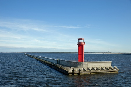 Red lighthouse on the breakwater. photo