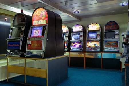 A row of slot machines or one armed bandits on board passenger. Photo taken on: March 05th, 2010 Stock Photo - 9735198