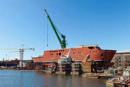 shipyard: Ship during construction works in a shipyard.