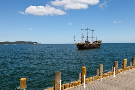 A the ship is approaching the pier in Sopot, Poland. Stock Photo - 9809981