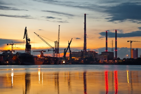 Industrial view at sunset in shipyard of Gdansk, Poland. Publikacyjne