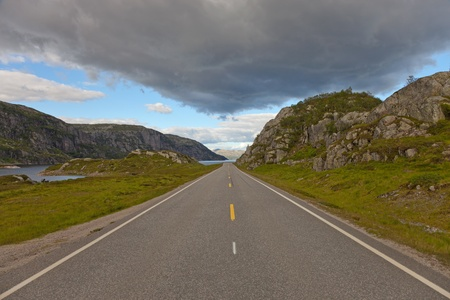 Scenic road and beautiful mountains in Norway. photo