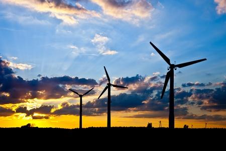 Wind power landscape at sunset.  photo
