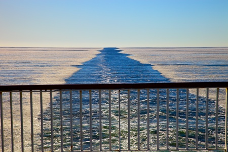 Wake in the frozen sea as seen from the stern of the ship. Stock Photo - 10635354
