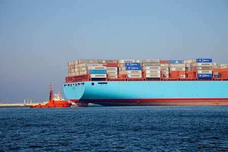tug boat: GDANSK, POLAND - OCTOBER 01: The Elly Maersk leaves the port, is currently one of the world Editorial