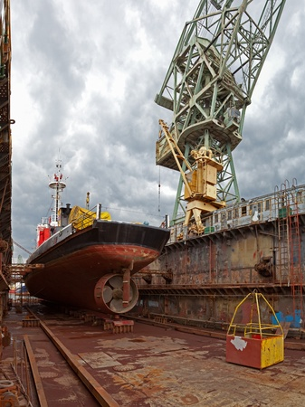 Repair of the vessel at the dock. Gdansk, Poland.  photo
