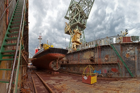 dockyard: Repair of the vessel at the dock. Gdansk, Poland.