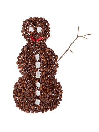 Snowman symbol made from coffee beans. photo